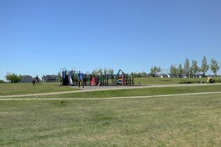 Photo 31: 76 Bridleridge Manor SW in Calgary: Bridlewood Row/Townhouse for sale : MLS®# A1106883