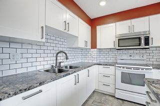 Photo 6: 8 3302 50 Street NW in Calgary: Varsity Row/Townhouse for sale : MLS®# A1120305