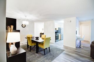 Photo 8: 209 2022 CANYON MEADOWS Drive SE in Calgary: Queensland Apartment for sale : MLS®# A1028544