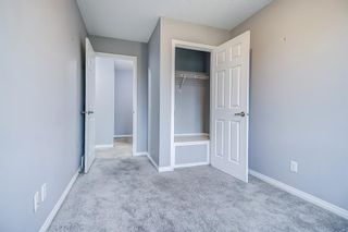 Photo 31: 129 Windstone Park SW: Airdrie Row/Townhouse for sale : MLS®# A1137155