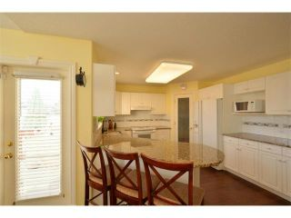 Photo 9: 14242 EVERGREEN View SW in Calgary: Shawnee Slps_Evergreen Est House for sale : MLS®# C4005021