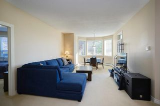 Photo 2: 112 26 Val Gardena View SW in Calgary: Springbank Hill Apartment for sale : MLS®# A1145110