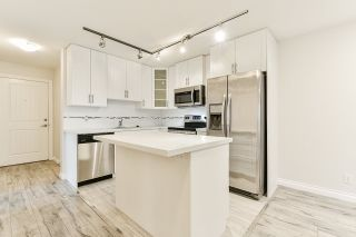 """Photo 4: 401 5650 201A Street in Langley: Langley City Condo for sale in """"Paddington Station"""" : MLS®# R2517171"""