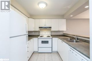 Photo 4: 117 EDGEHILL Drive Unit# 104 in Barrie: Condo for sale : MLS®# 40147841