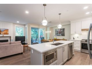 """Photo 4: 109 8217 204B Street in Langley: Willoughby Heights Townhouse for sale in """"Ironwood"""" : MLS®# R2505195"""