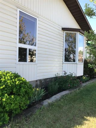 Photo 8: 35 Ranchlands Crescent NW in Calgary: Ranchlands Detached for sale : MLS®# A1115459