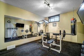 Photo 36: 102 Ridge View Place: Cochrane Detached for sale : MLS®# A1147672