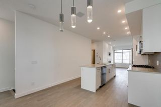 Photo 6: 104 1616 24th Ave NW in Calgary: Capitol Hill Row/Townhouse for sale : MLS®# A1104099