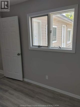 Photo 7: 900 ELSMERE Unit# A in Windsor: House for lease : MLS®# 21002807
