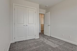 Photo 25: 132 Creekside Drive SW in Calgary: C-168 Semi Detached for sale : MLS®# A1144861