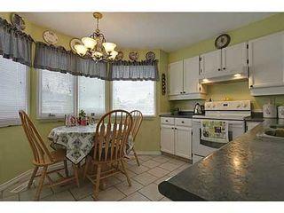 Photo 6: 22 COACHWAY Green SW in Calgary: 4 Level Split for sale : MLS®# C3572923