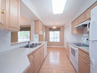 "Photo 11: 220 13880 70 Avenue in Surrey: East Newton Condo for sale in ""Chelsea Gardens"" : MLS®# R2288215"
