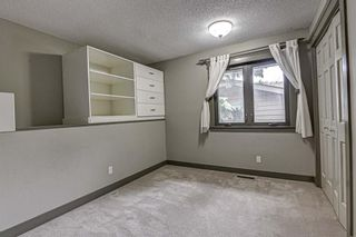 Photo 24: 512 Coach Grove Road SW in Calgary: Coach Hill Detached for sale : MLS®# A1127138