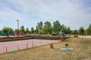 Photo 33: 105 Rocky Ridge Court NW in Calgary: Rocky Ridge Row/Townhouse for sale : MLS®# A1069587
