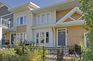 Photo 2: 105 AUBURN BAY Square SE in Calgary: Auburn Bay Row/Townhouse for sale : MLS®# C4278130