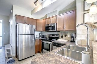 Photo 16: 9 169 Rockyledge View NW in Calgary: Rocky Ridge Row/Townhouse for sale : MLS®# A1153387