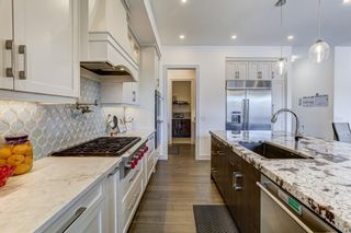 Photo 11: 907 31 Avenue NW in Calgary: Cambrian Heights Detached for sale : MLS®# A1095749