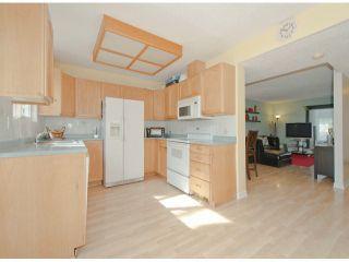 """Photo 2: 6936 134 ST in Surrey: West Newton 1/2 Duplex for sale in """"Bentley"""" : MLS®# F1309630"""
