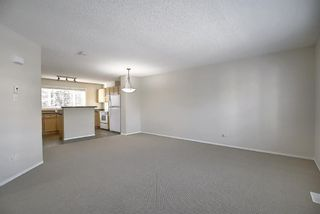 Photo 5: 25 Tuscany Springs Gardens NW in Calgary: Tuscany Row/Townhouse for sale : MLS®# A1053153