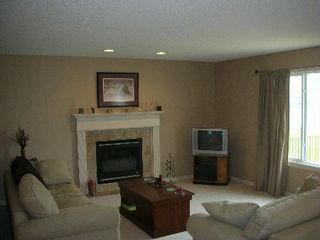 Photo 3: 1212 - 84 Street  SW: House for sale (Summerside)