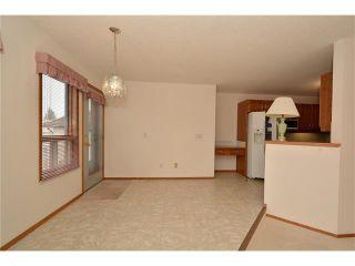 Photo 11: 12 WEST COPITHORNE Place: Cochrane House for sale : MLS®# C4049219