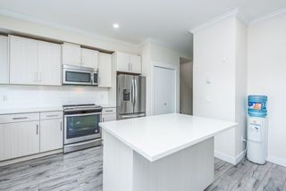 """Photo 11: 32 7247 140 Street in Surrey: East Newton Townhouse for sale in """"GREENWOOD TOWNHOMES"""" : MLS®# R2544191"""