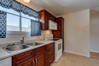 Photo 9: 302 Whitney Crescent SE in Calgary: Willow Park Detached for sale : MLS®# A1146432