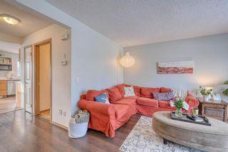 Photo 4: 108 Bridleridge Gardens SW in Calgary: Bridlewood Detached for sale : MLS®# A1071298