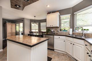"Photo 10: 8110 164 Street in Surrey: Fleetwood Tynehead House for sale in ""FLEETWOOD PARK"" : MLS®# R2610443"