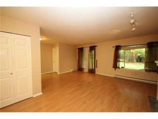 """Photo 2: 105 515 WHITING Way in Coquitlam: Coquitlam West Condo for sale in """"Brookside Manor"""" : MLS®# V903579"""