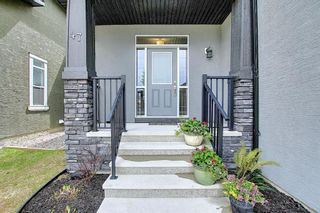 Photo 3: 47 ASPENSHIRE Drive SW in Calgary: Aspen Woods Detached for sale : MLS®# A1106772