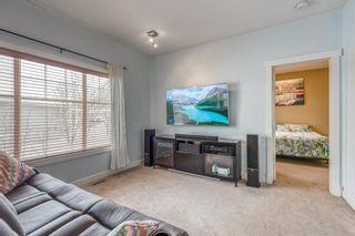 Photo 15: 1401 281 COUGAR RIDGE Drive SW in Calgary: Cougar Ridge Row/Townhouse for sale : MLS®# A1070231