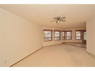 Photo 5: 12 WEST COPITHORNE Place: Cochrane House for sale : MLS®# C4049219