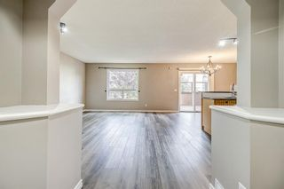 Photo 4: 52 COUGARSTONE Villa SW in Calgary: Cougar Ridge Detached for sale : MLS®# A1020063