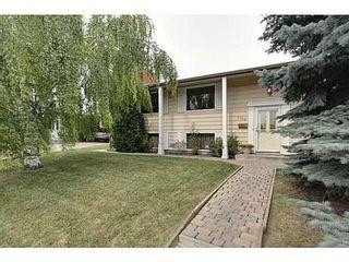 Photo 1: 6135 LONGMOOR Way SW in Calgary: Bi-Level for sale : MLS®# C3584023