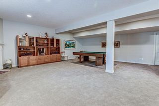 Photo 35: 7 ELYSIAN Crescent SW in Calgary: Springbank Hill Semi Detached for sale : MLS®# A1104538