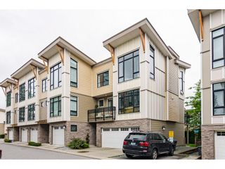 """Photo 1: 62 9989 BARNSTON Drive in Surrey: Fraser Heights Townhouse for sale in """"HIGHCREST"""" (North Surrey)  : MLS®# R2471184"""
