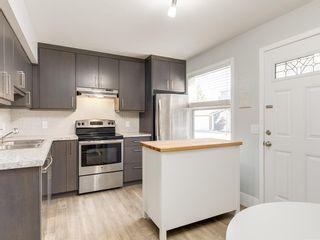 Photo 8: 266 REGAL Park NE in Calgary: Renfrew Row/Townhouse for sale : MLS®# A1059022