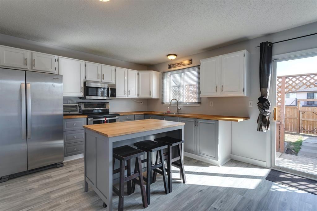 Main Photo: 29 Abberfield Crescent NE in Calgary: Abbeydale Semi Detached for sale : MLS®# A1091796