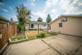 Photo 7: 12023 Candiac Road SW in Calgary: Canyon Meadows Detached for sale : MLS®# A1128675