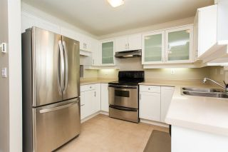 """Photo 2: 408 5465 201 Street in Langley: Langley City Condo for sale in """"Briarwood Park"""" : MLS®# R2393279"""