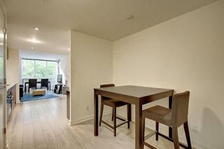 Photo 8: 114 51 WATERFRONT Mews SW in Calgary: Chinatown Apartment for sale : MLS®# C4301606