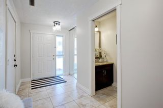 Photo 12: 212 Coachway Lane SW in Calgary: Coach Hill Row/Townhouse for sale : MLS®# A1153091