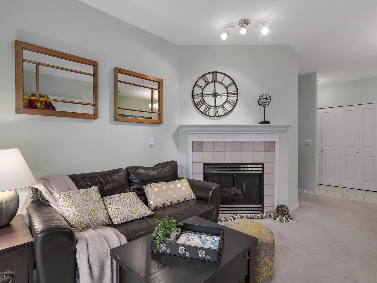 The bright well laid out living room offers a cozy gas fireplace that is included in your monthly fee.