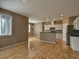 Photo 8: 305 Bayside Place SW: Airdrie Detached for sale : MLS®# A1116379