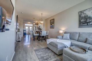 Photo 4: 100 Legacy Main Street SE in Calgary: Legacy Row/Townhouse for sale : MLS®# A1095155