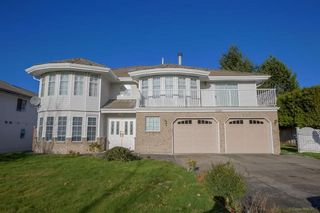Photo 1: 12345 71A Avenue in Surrey: West Newton House for sale : MLS®# R2489810