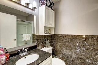 Photo 20: 136 Georgian Villas NE in Calgary: Marlborough Park Row/Townhouse for sale : MLS®# A1100929