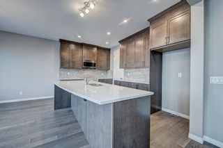 Photo 13: 102 Yorkstone Way SW in Calgary: Yorkville Detached for sale : MLS®# A1055580