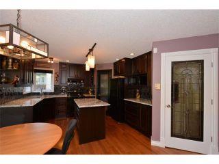 Photo 14: 148 GLENEAGLES Close: Cochrane House for sale : MLS®# C4010996